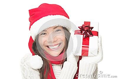 Christmas woman holding gift smiling