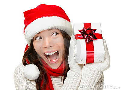 Christmas woman holding present excited