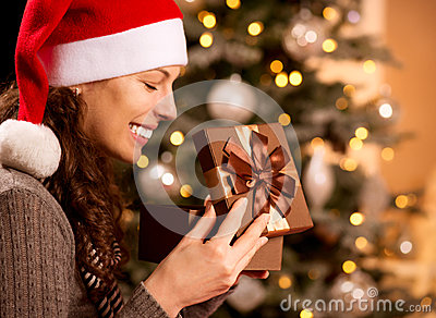 Christmas. Woman opening Gift box