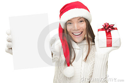 Christmas woman showing copy space sign