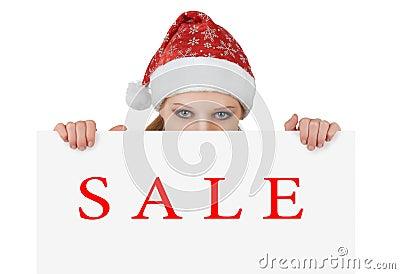 Christmas  woman is showing  empty billboard