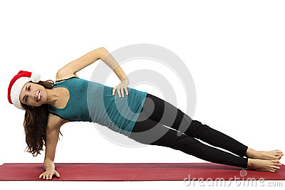Christmas yoga woman in side plank pose Stock Photo