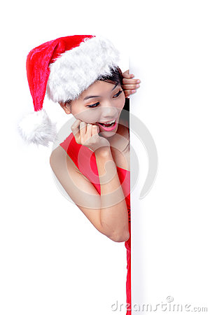 Christmas young girl showing blank billboard