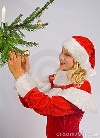 Christmasgirl is decorating a christmas-tree
