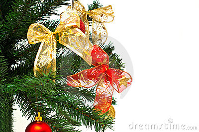 Christmass tree branches with balls and ribbons