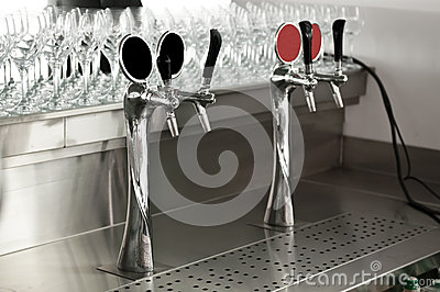 Chrome beer taps at the bar