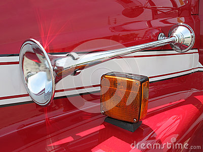 Chrome horn on a red fender