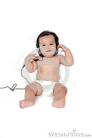 a chubby little girl listen to music