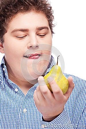 Chubby man holding pear