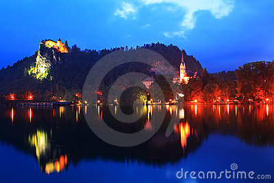 Church and castle in Bled lake in Slovenia evening