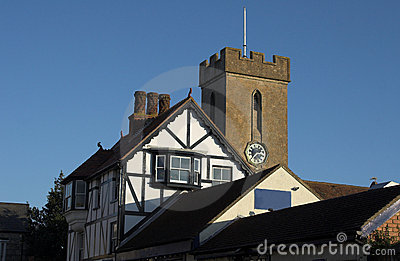Church clock tower with timber building