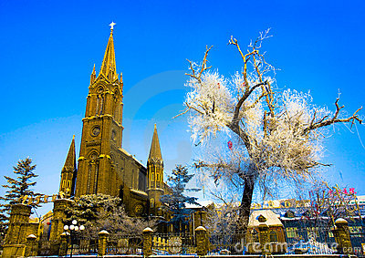 Church & frost covered tree Editorial Stock Photo