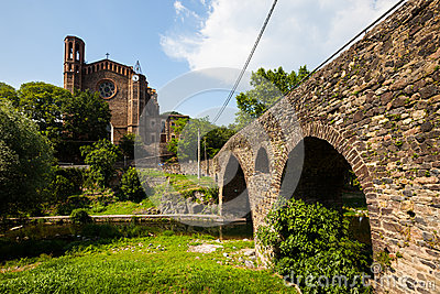 Church and medieval bridge in Sant Joan les Fonts