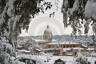 Church of Rome under snowfall Editorial Photo