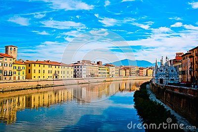 Church Santa Maria della Spina on the Arno river embankment in Pisa with colorful old houses, Italy, Europe. Stock Photo