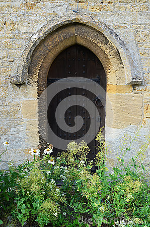 Church side door with wild flowers