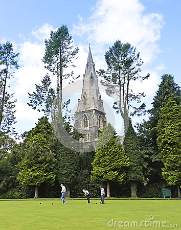 A Church Steeple and Bowling Green, Ambleside Editorial Photo