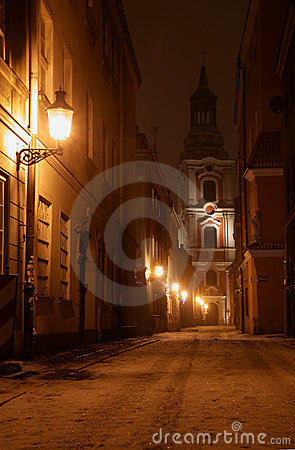 Church tower at night in Poznan