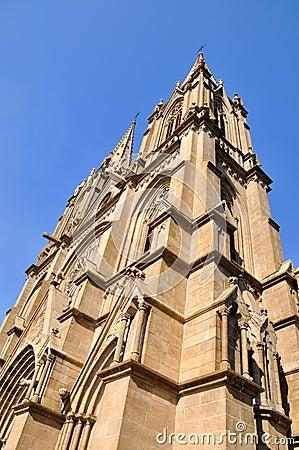 Church tower under blue sky