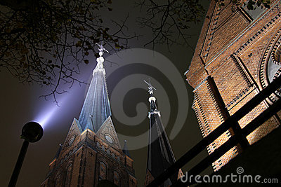 Church with twin tower by night.