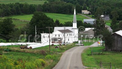 Church in the Valley. A small town church in the valley among the forested hills stock footage