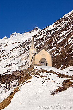 Church in winter alpine landscape