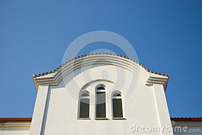White church window against blue sky