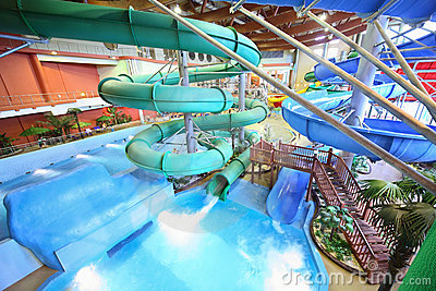 Chutes as spiral and staircase in aquapark Editorial Stock Photo