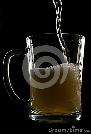 Cider being poured into pint glass