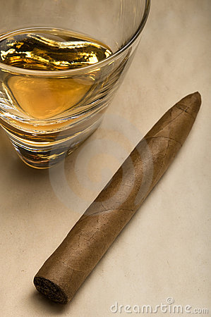 Cigar and a glass of Whisky