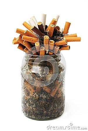 Free Cigar Stubs In Jar Stock Image - 8229321