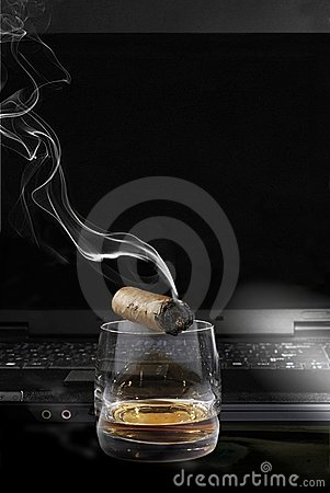Cigar and Whisky(on a background of notebook)