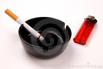 Cigarette in ashtray with ligh
