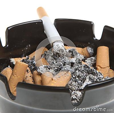 Cigarette Smoking in Ashtray