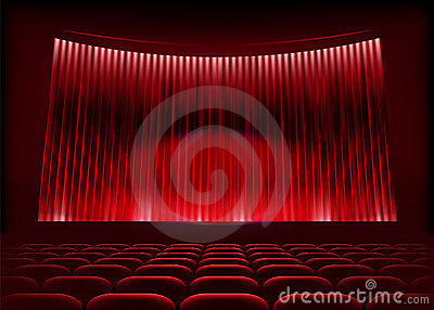 Cinema auditorium with stage curtain.