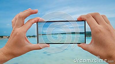 Cinemagraph de prendre la photo mobile du paysage marin avec Crystal Clear Turquoise Water chez Sunny Day Compartiment tropical d banque de vidéos