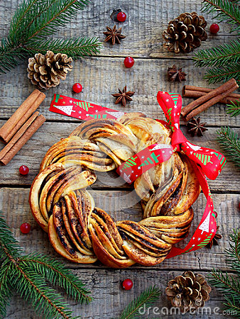 Free Cinnamon Cocoa Brown Sugar Wreath Buns. Sweet Homemade Christmas Baking. Roll Bread, Spices, Decoration On Wooden Background. New Stock Photo - 99091010
