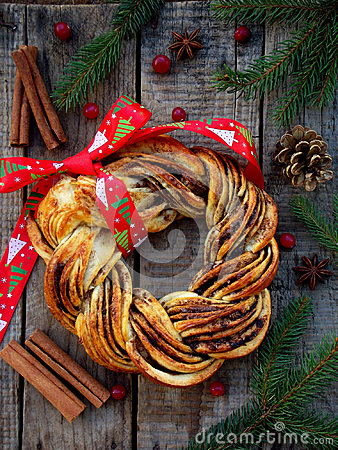 Free Cinnamon Cocoa Brown Sugar Wreath Buns. Sweet Homemade Christmas Baking. Roll Bread, Spices, Decoration On Wooden Background. New Stock Photo - 99092250