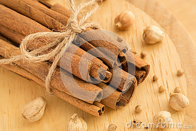 Cinnamon sticks, cardamon seeds and coriander seeds