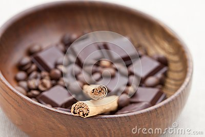 Cinnamon sticks with chocolate and coffee beans