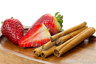 Cinnamon sticks and fresh stawberries