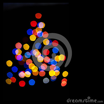 Circles bokeh of Christmaslight in the form of a C