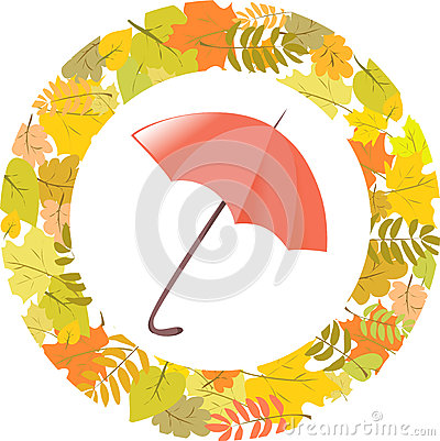 Circular pattern of autumn leaves and umbrella