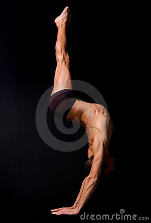 Circus actor standing on hands