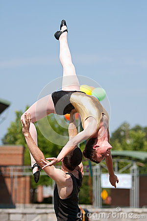 Circus Performer Lifts Female Over His Head Editorial Photography
