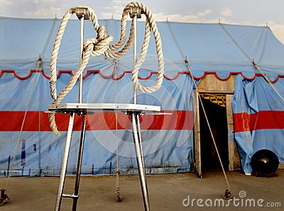 Circus symbolism. A wattled rope on a metal stage