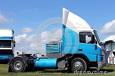 Circus trucks in field