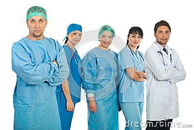 Cirurgião adulto meados de e sua equipe