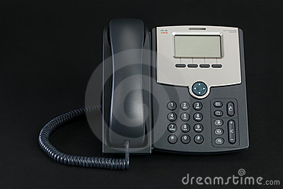 Cisco VoIP Phone Isolated on Dark Background Editorial Stock Photo