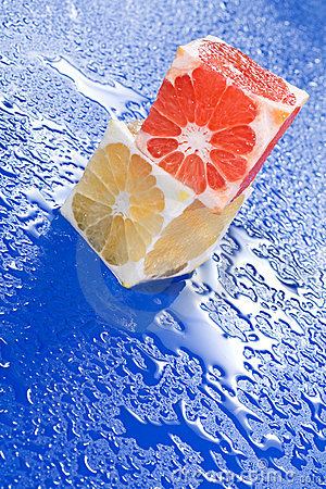Citrus cubes on wet surface